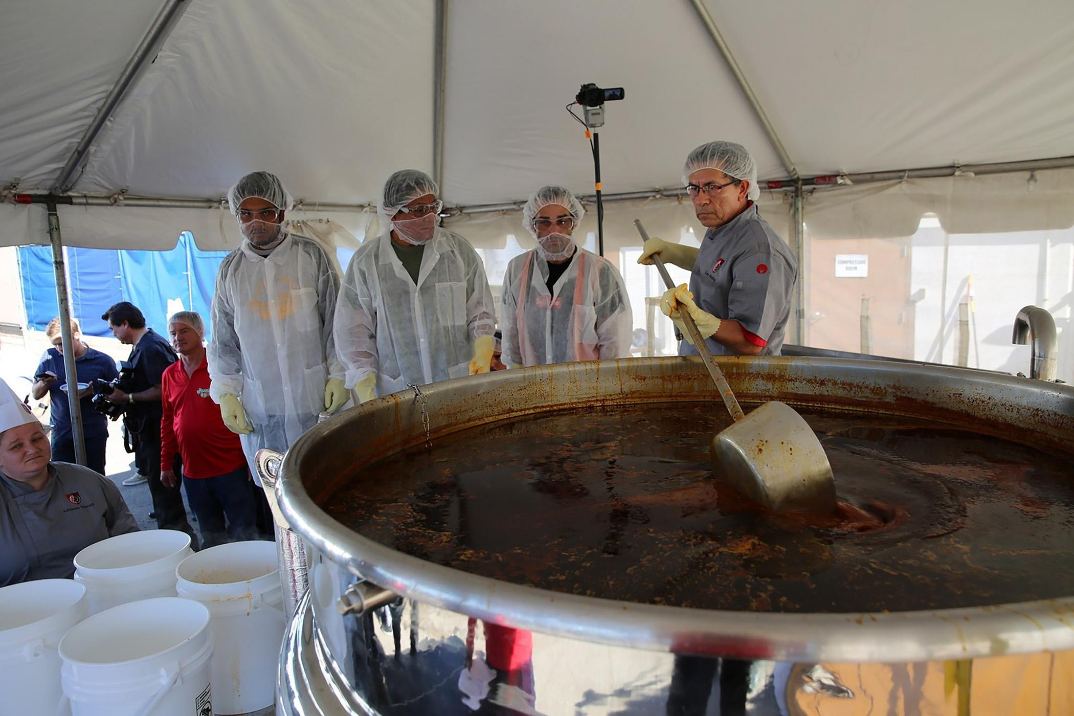 Chefs from Juanita's Foods along with culinary students and instructors from The Art Institute of Washington, a branch of the Art Institute of Atlanta, whip up a nearly 2,500-pound pot of Menudo Soup.